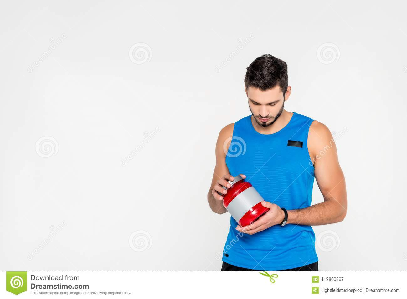 Athletic Young Sportsman Holding Sport Supplement Jar Stock