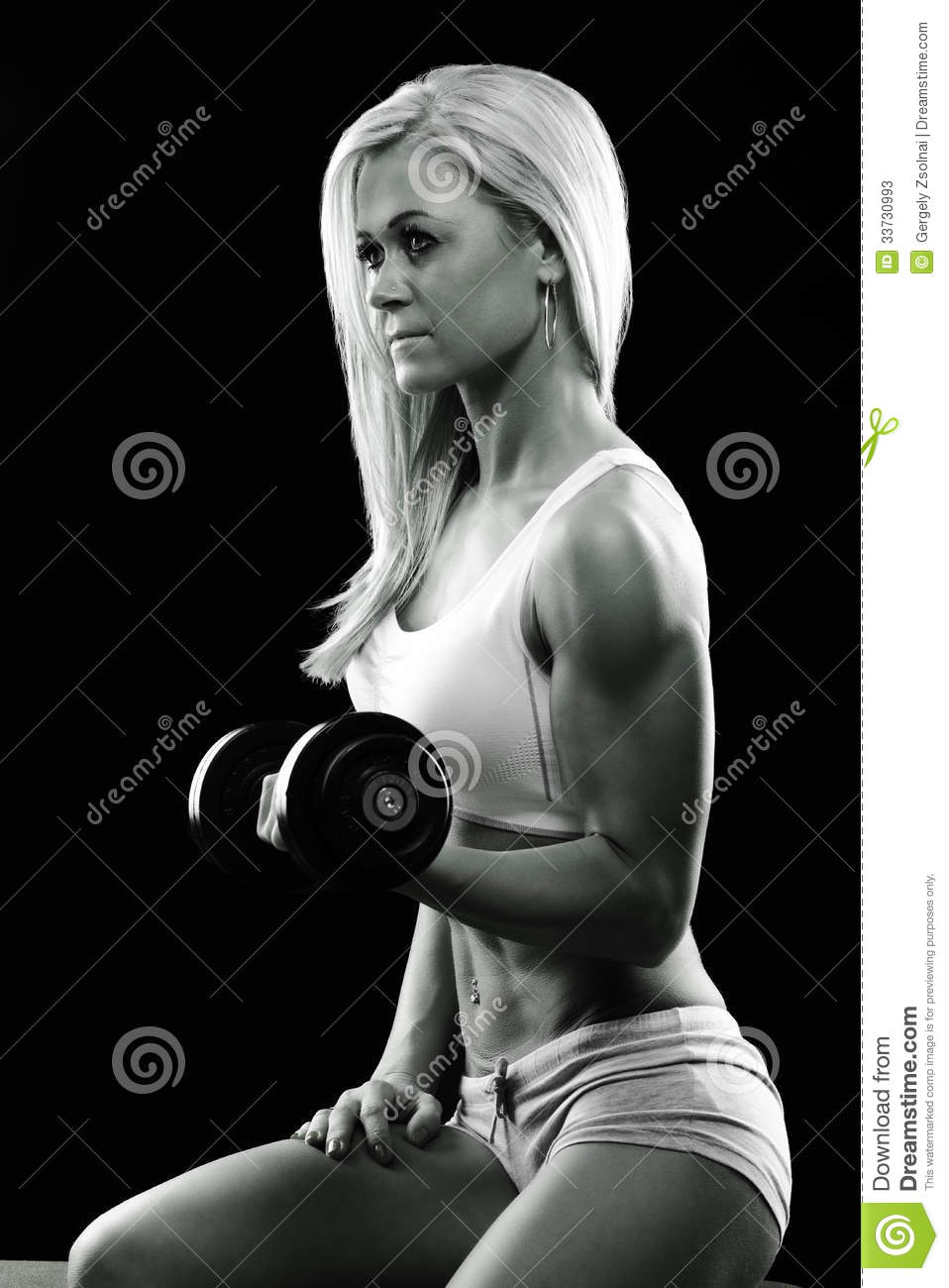 Athletic young woman doing a fitness workout with weights