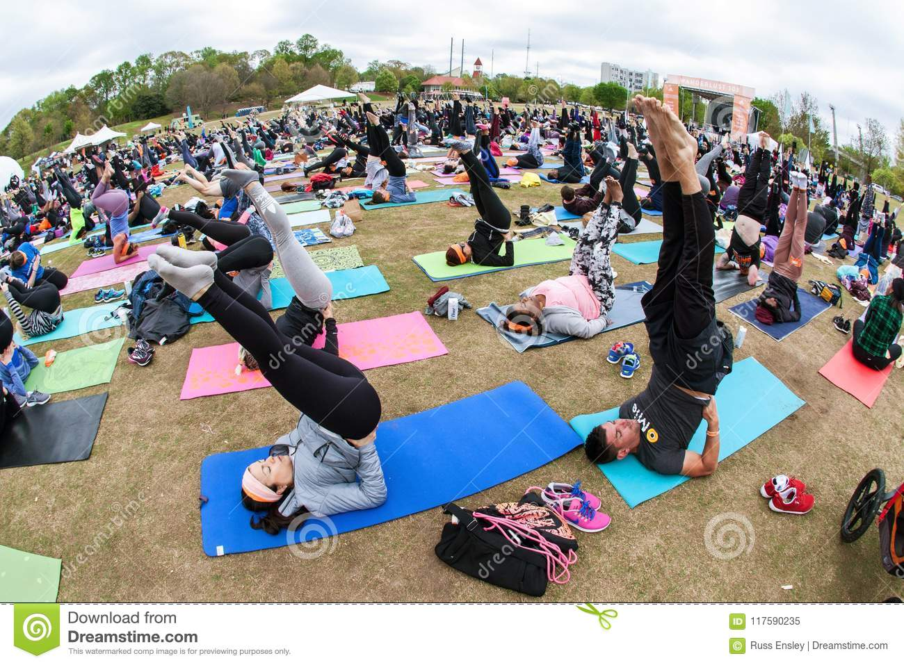 Dozens Of People Point Toes Upward Doing Yoga Pose Outdoors Editorial Image Image Of Doing Exercise 117590235