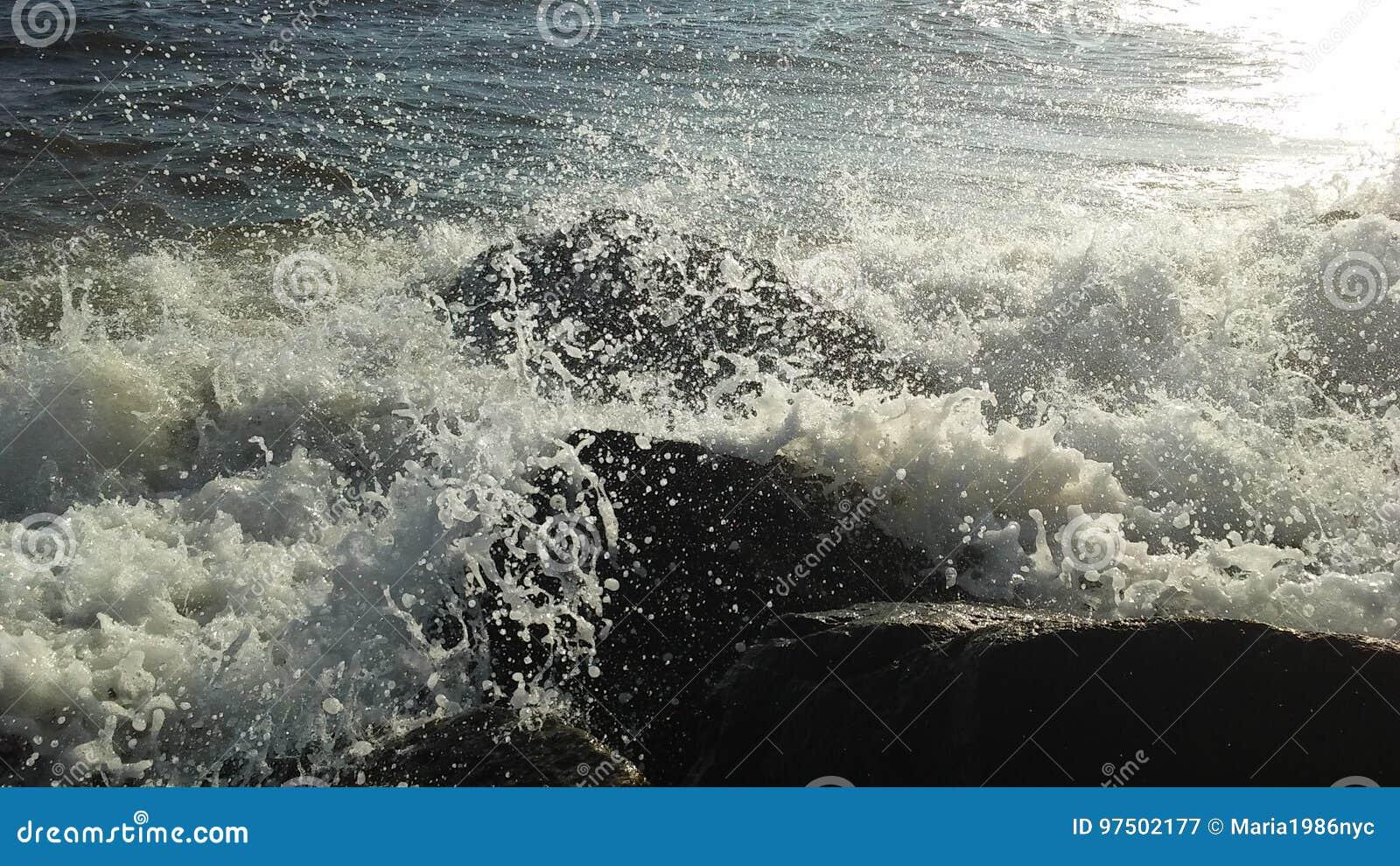 Atlantic Ocean Waves On Coney Island Beach In Bright Sunlight In
