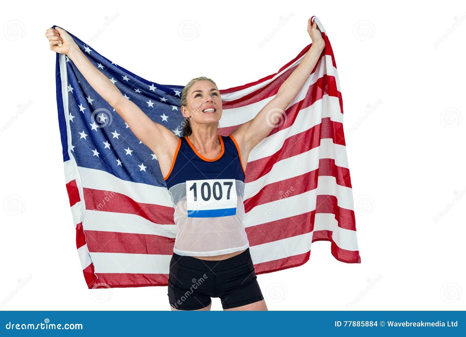 Atleta Que Presenta Con La Bandera Americana Después De La Victoria Foto de archivo