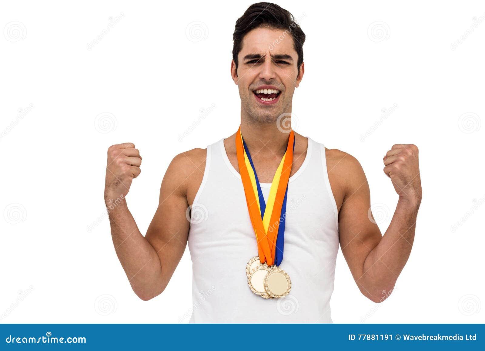 Atleta Que Presenta Con La Medalla De Oro Después De La Victoria Foto de archivo