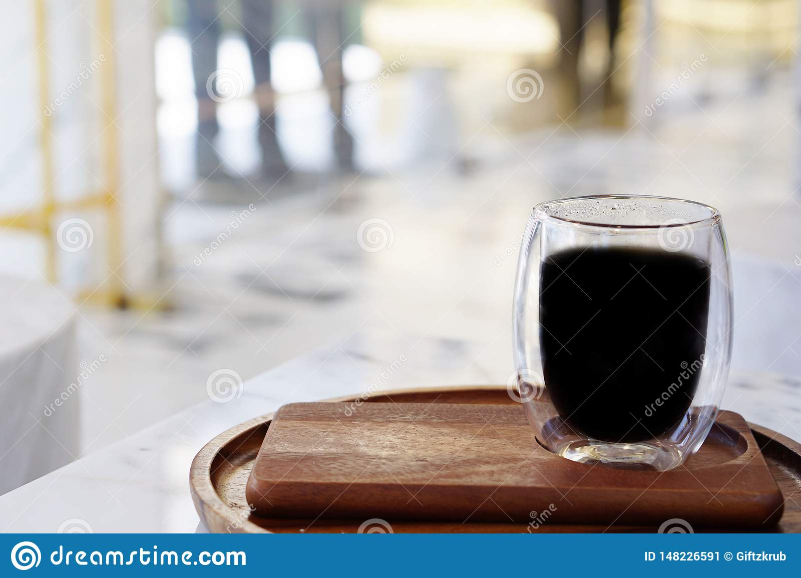 The atmosphere in the shop with a cup of coffee with a blurred background and light.