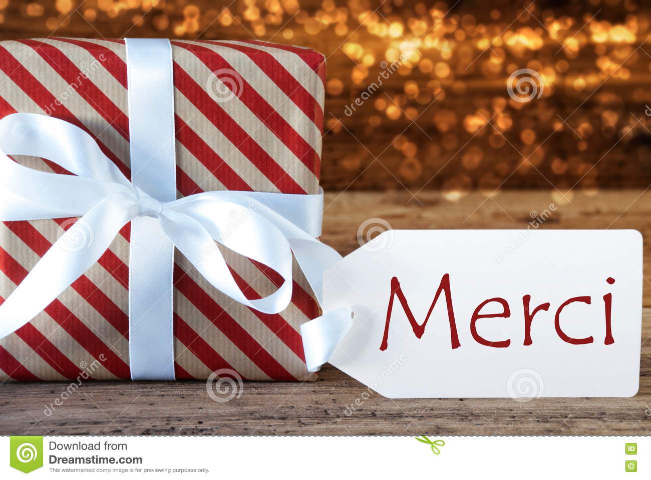 Atmospheric Christmas Gift With Label, Merci Means Thank You Stock ...