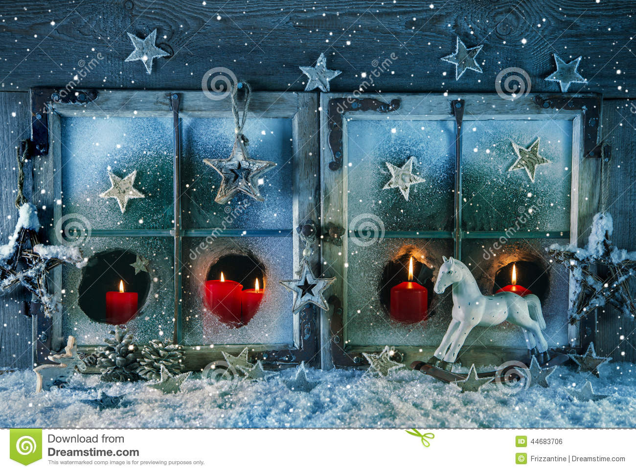 atmospheric christmas window with red candles outdoor with snow idea for a greeting card stock. Black Bedroom Furniture Sets. Home Design Ideas