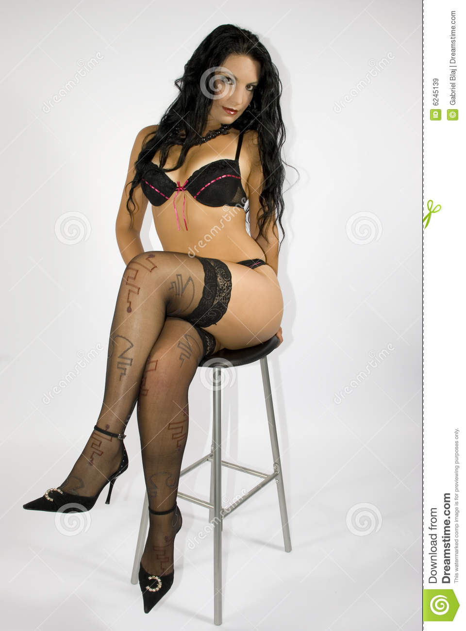 Atractive Woman On Chair Royalty Free Stock Images