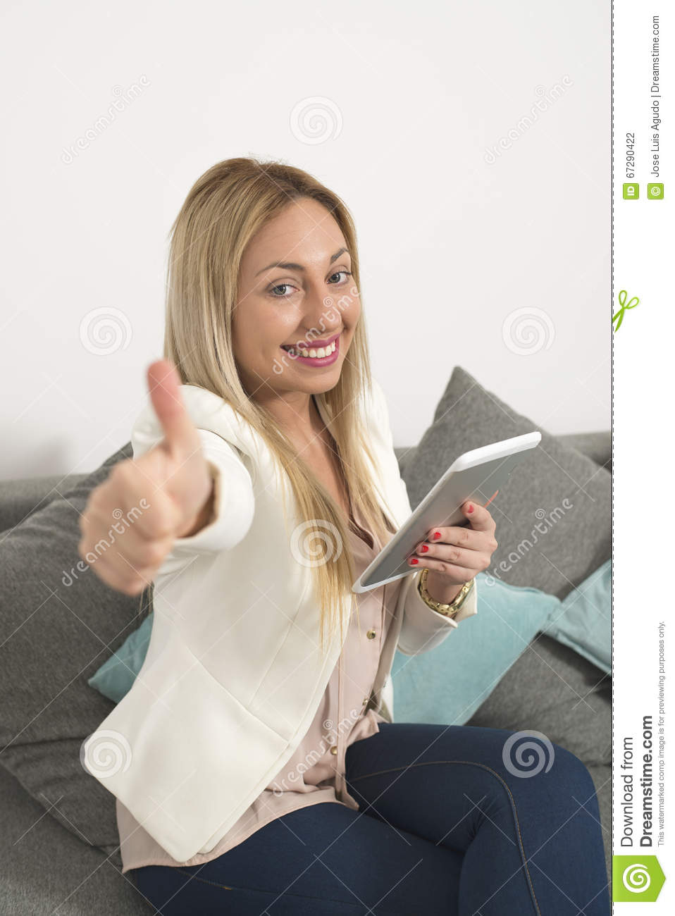 Atracttive woman with a tablet