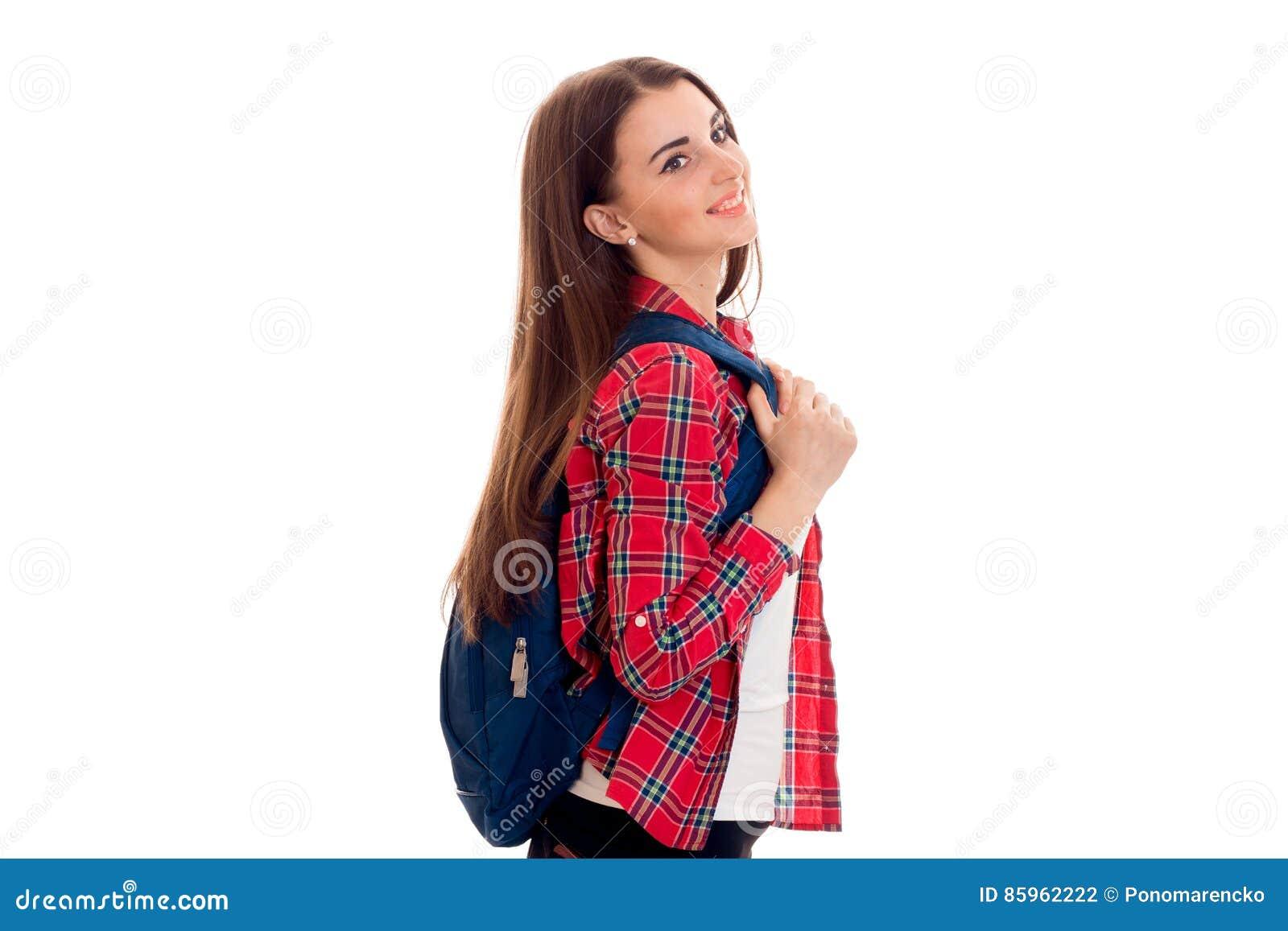 Atrakcyjnej młodej brunetki studencka dziewczyna z błękitnym plecakiem odizolowywającym na białym tle