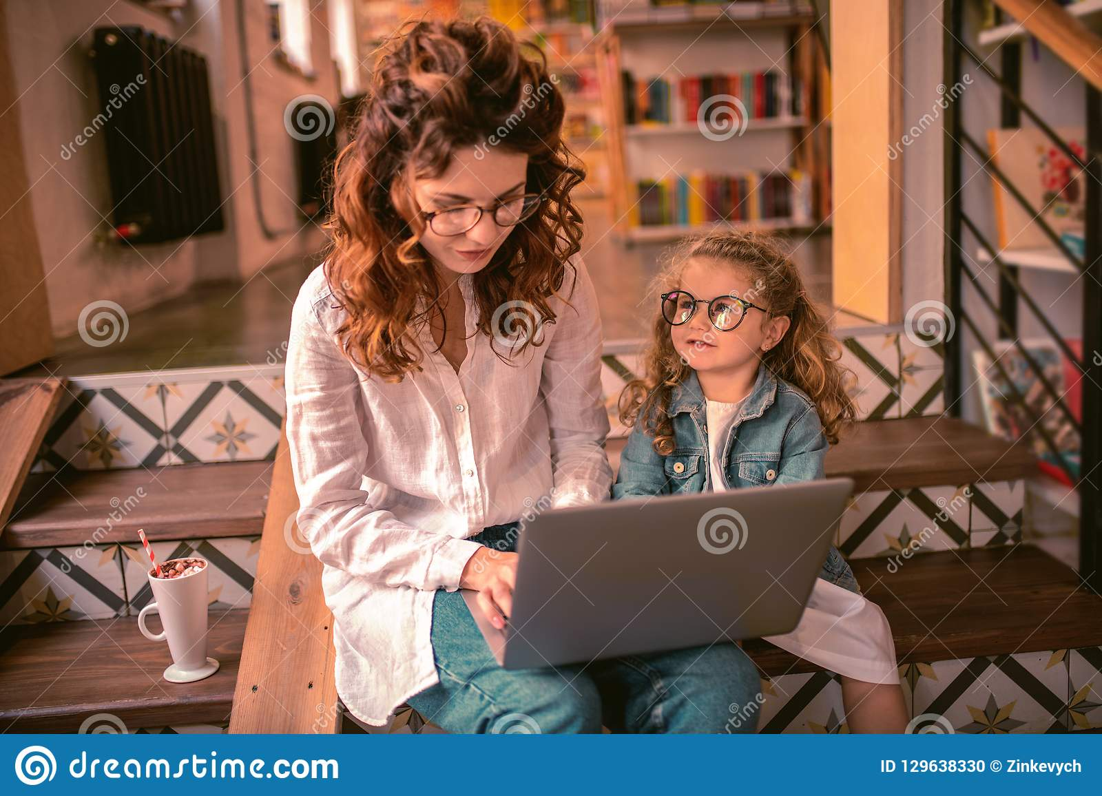 Attentive Charming Woman Typing Message To Her Friend Stock