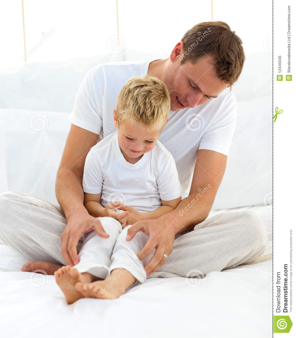 attentive dad hugging his son stock image image 12445045. Black Bedroom Furniture Sets. Home Design Ideas