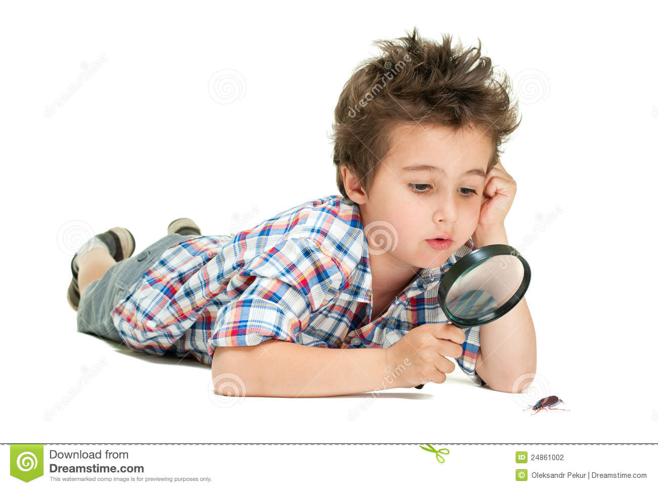 Stock Fotos E Imágenes: Attentive Little Boy With Weird Stock Photo