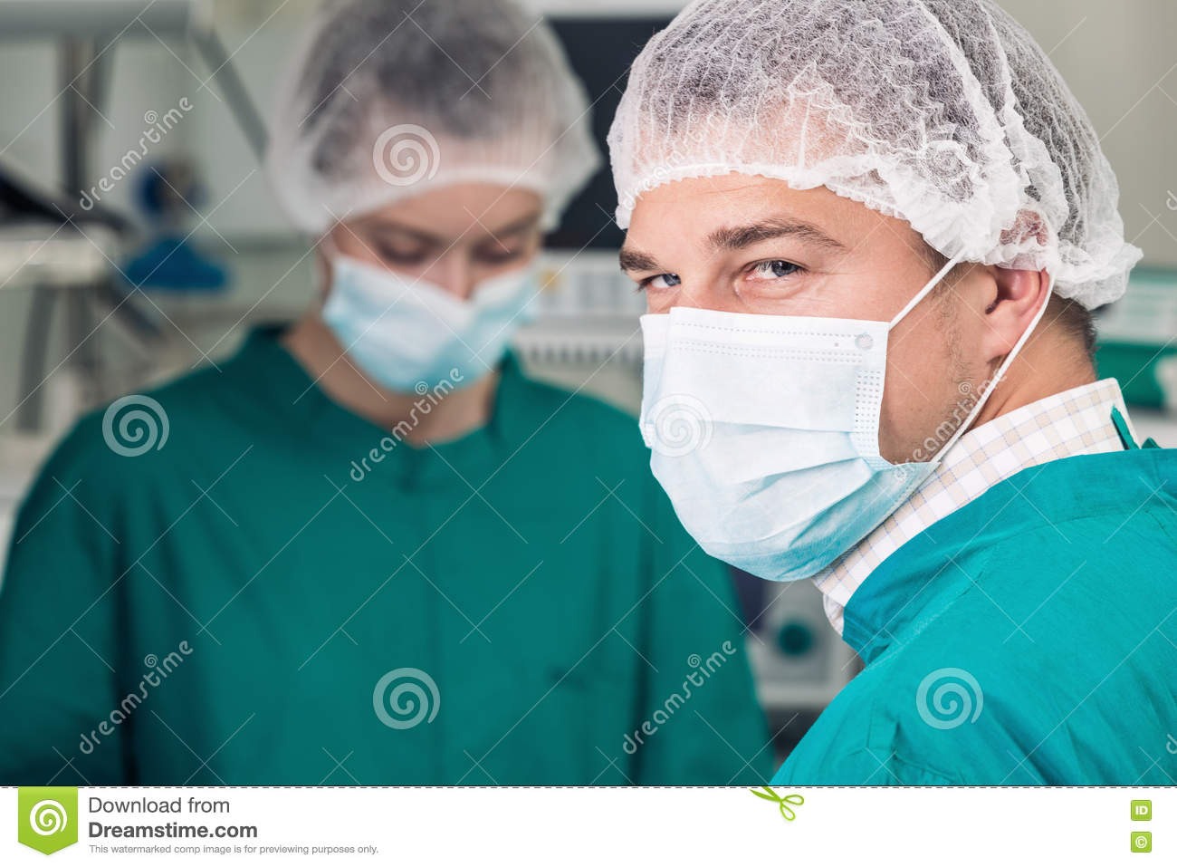 Attentive look of surgeon in mask