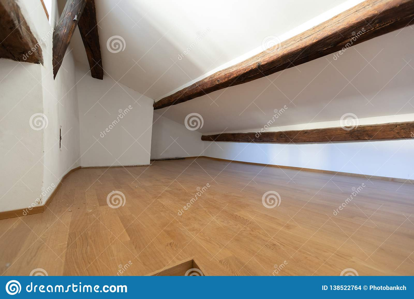 Attic with wooden beams and parquet