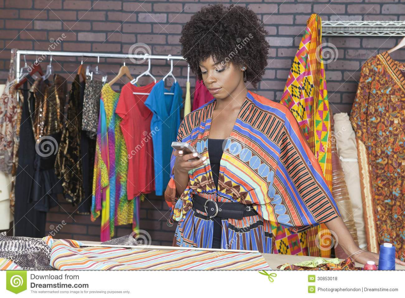 Attractive African American Female Fashion Designer Using Cell Phone Stock Photo Image Of Ethnicity Hanger 30853018