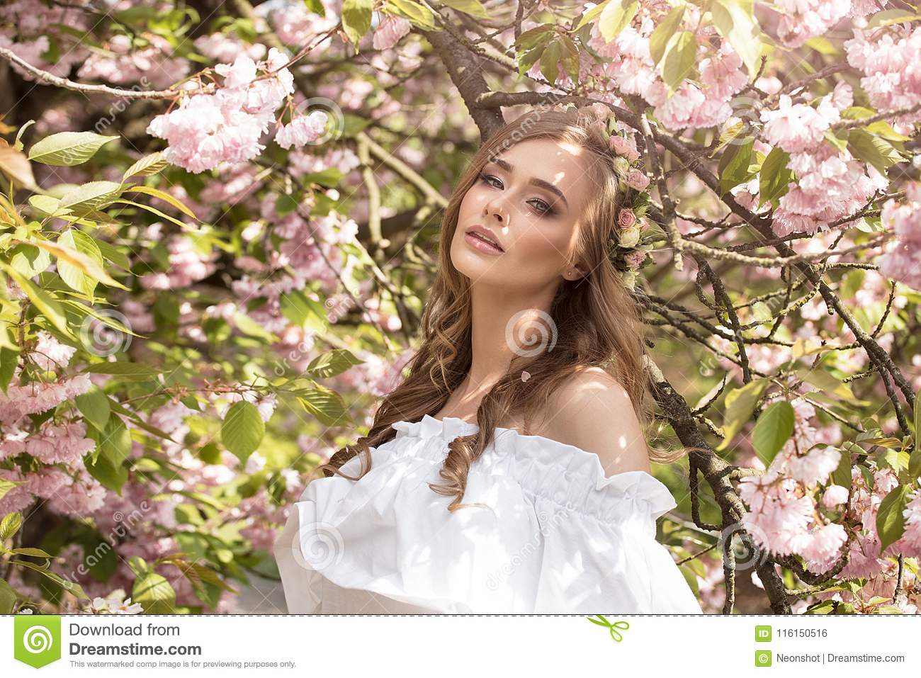 Attractive Blonde Girl In Blooming Garden. Stock Photo - Image of ...