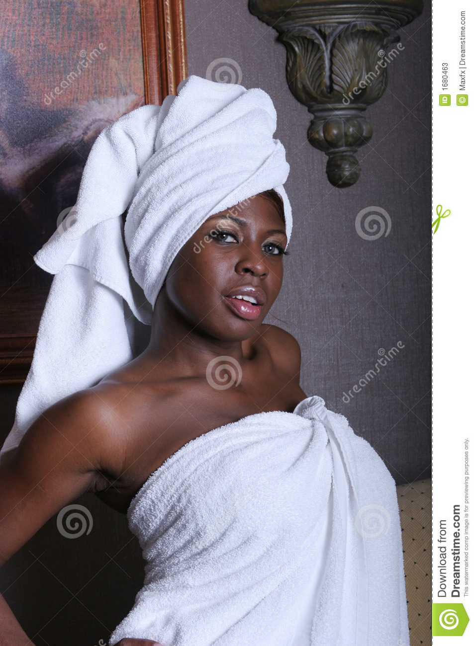 Attractive black woman in towels