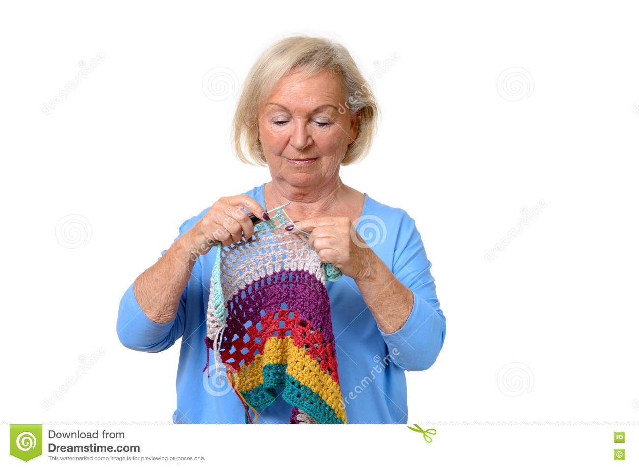 Attractive blond senior lady doing her knitting