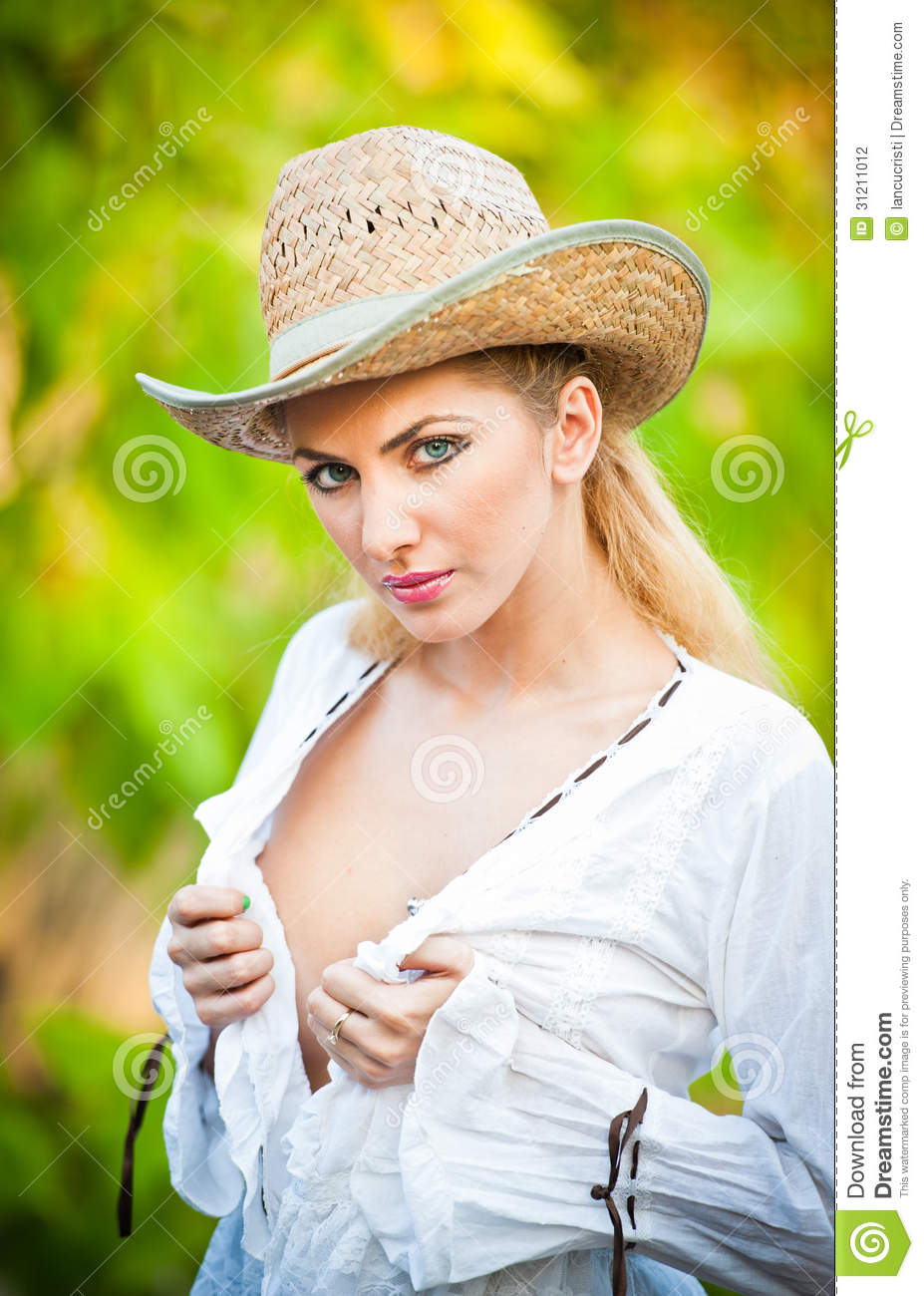 Beautiful young woman with straw hat and white kaftan in the  forest.Gorgeous blond haired blue eyes while wearing a straw cowboy hat 109b34e20c1f