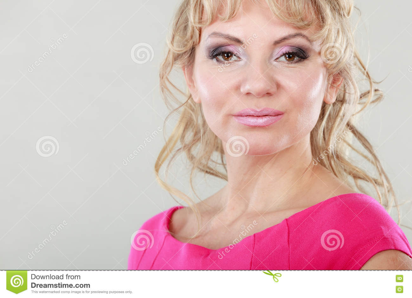 Curly blonde mature