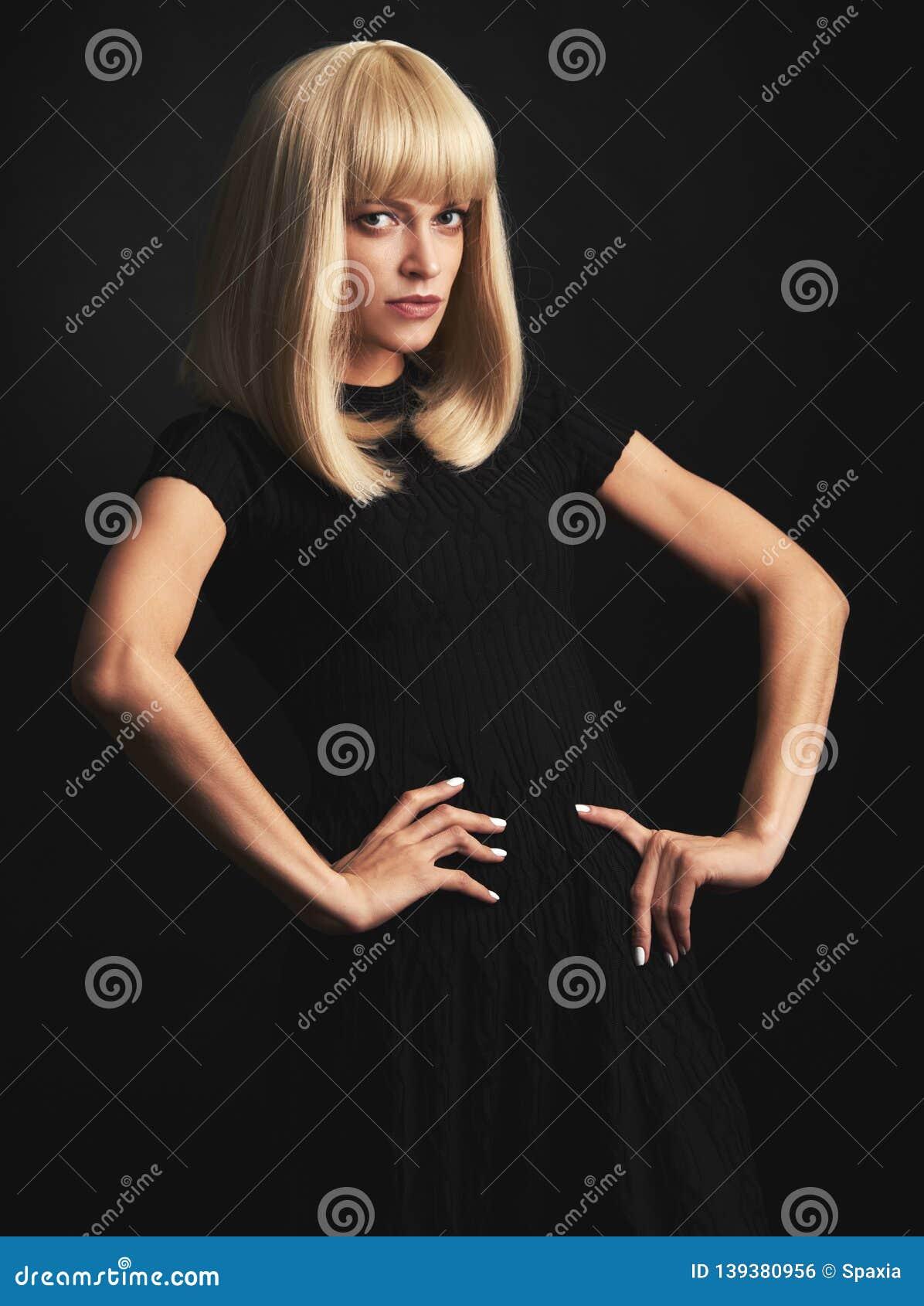 Attractive blonde woman studio portrait