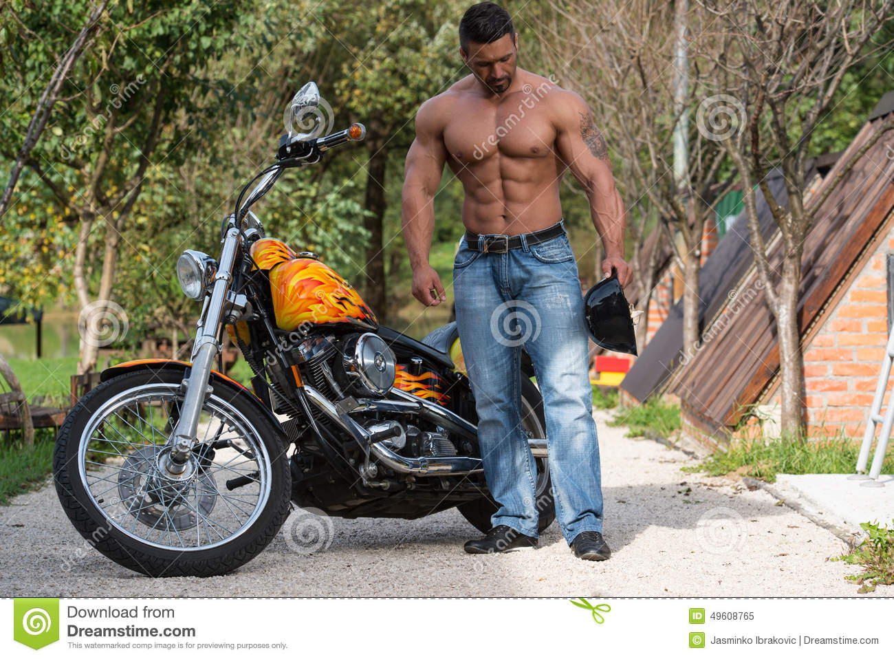 Attractive Bodybuilder And Motorcycle Stock Photo - Image