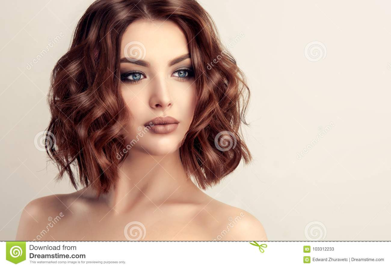 attractive brown haired woman with modern trendy and elegant