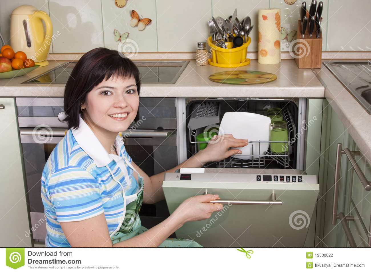 Attractive Brunette Woman Cleaning Kitchen Stock ...