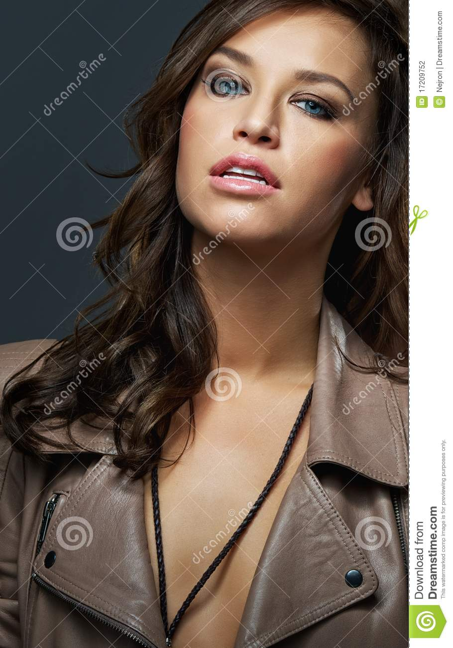Attractive Brunette Woman Isolated On Grey Stock