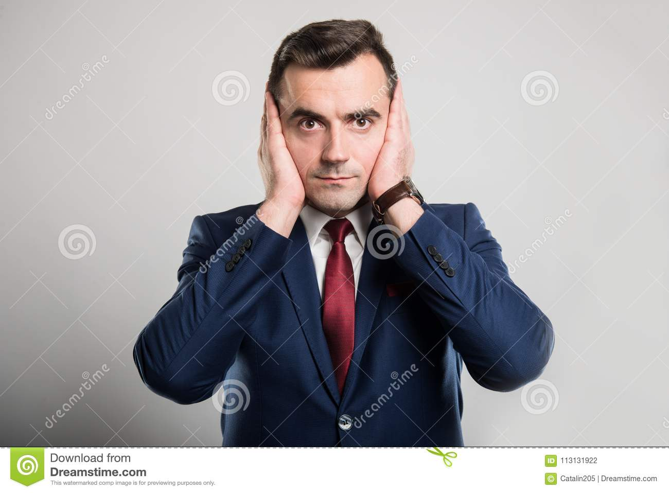Attractive business man covering ears like deaf gesture