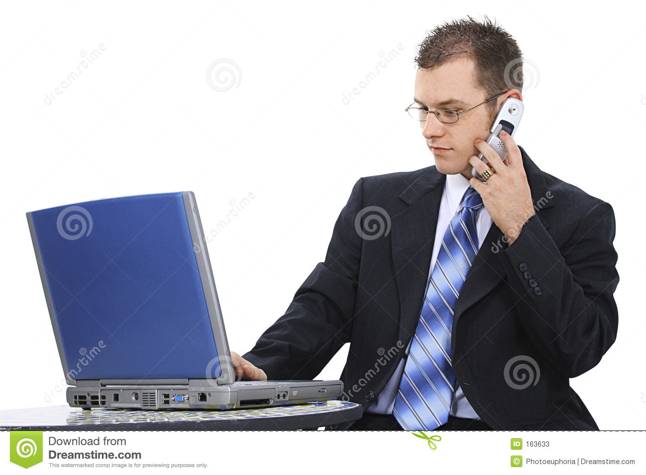 Attractive Business Man In Suit With Computer And