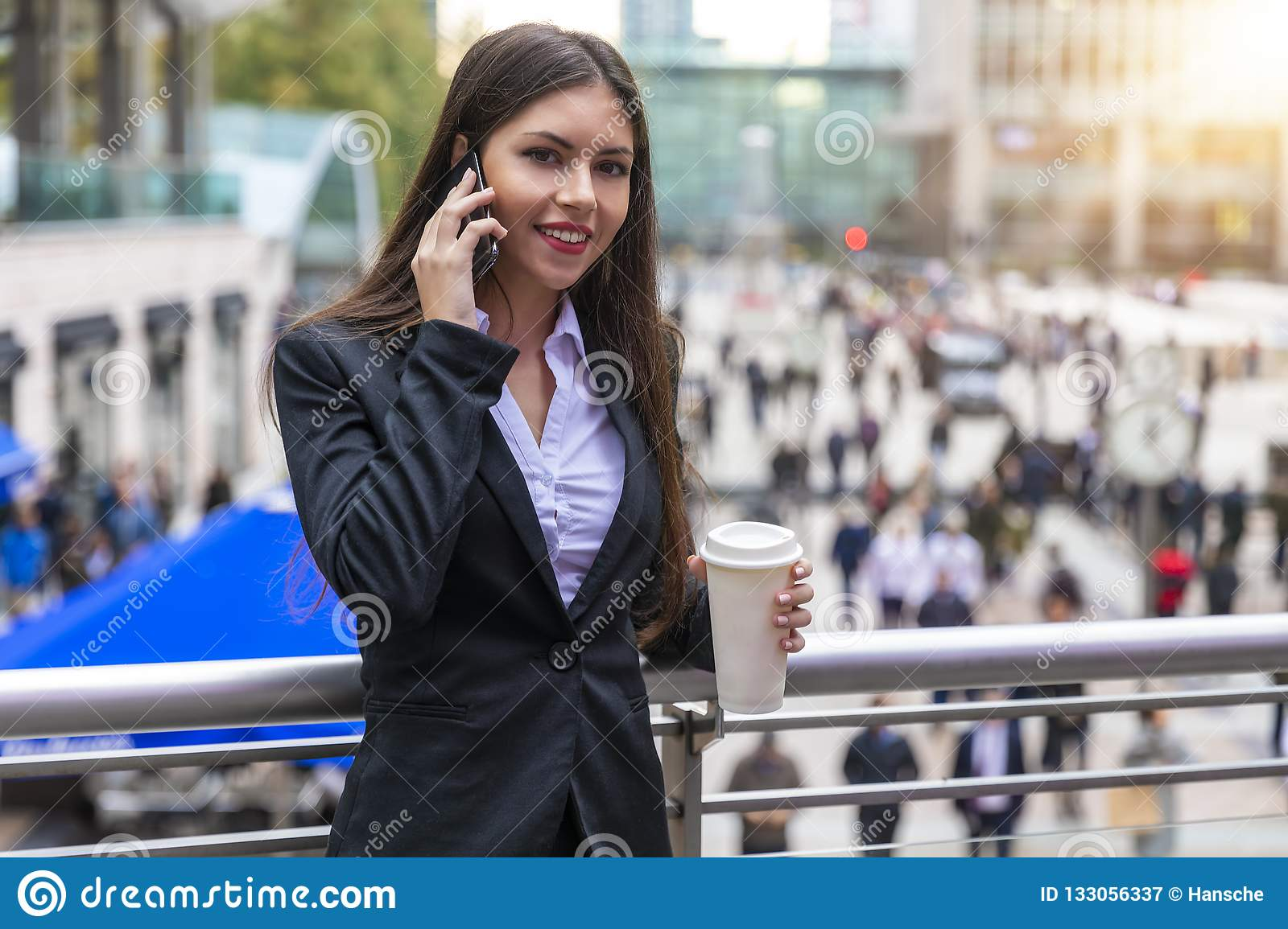 Attractive business woman in the financial district Canary Wharf of London, United Kingdom