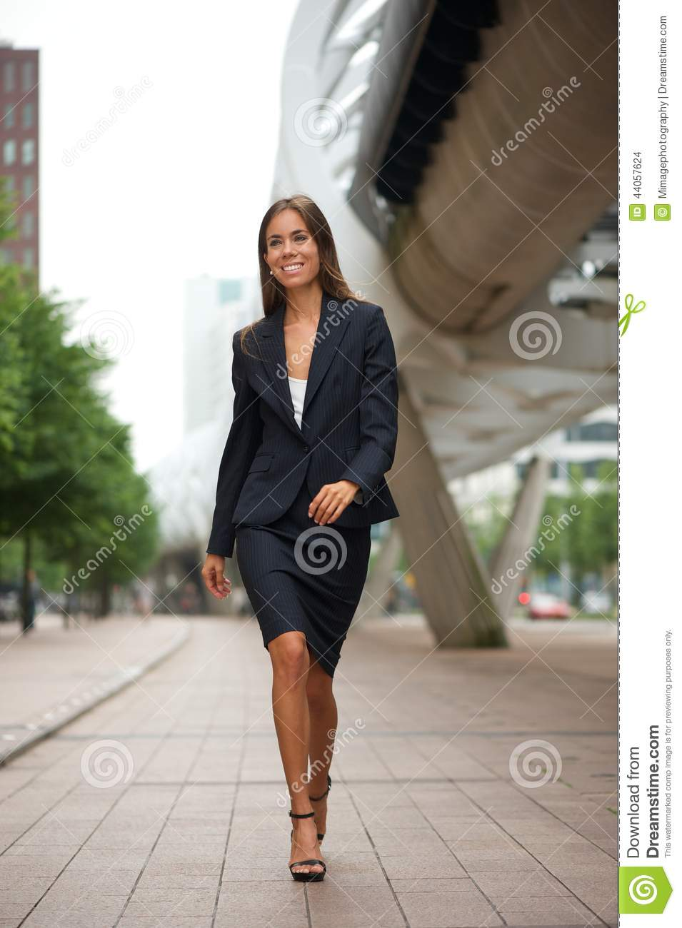 attractive business woman walking downtown stock photo