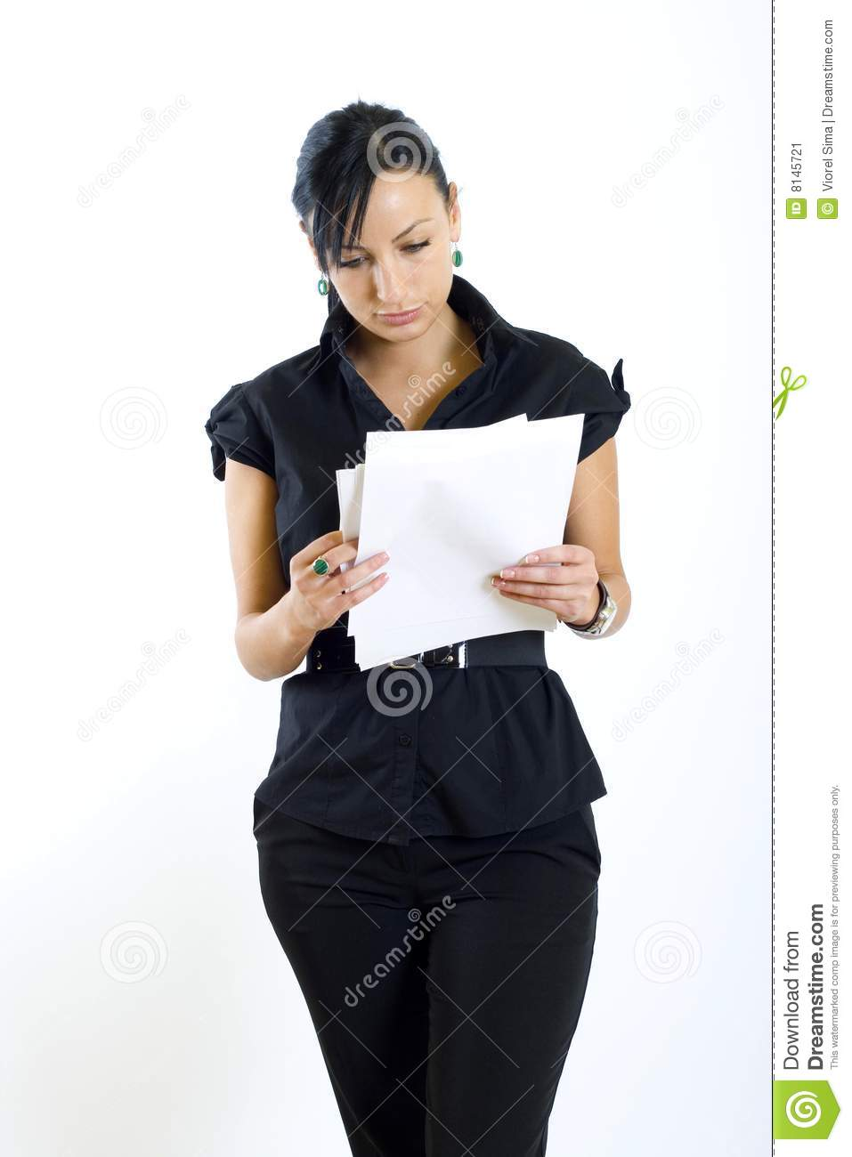 Attractive businesswoman holding papers