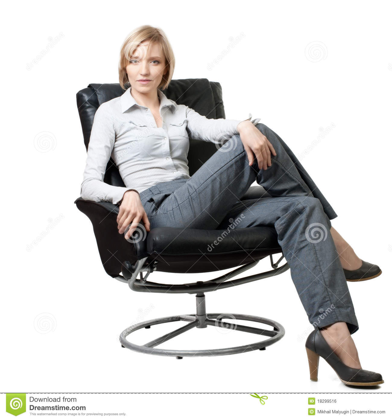 Attractive businesswoman sitting in the armchair royalty for Sitting in armchair