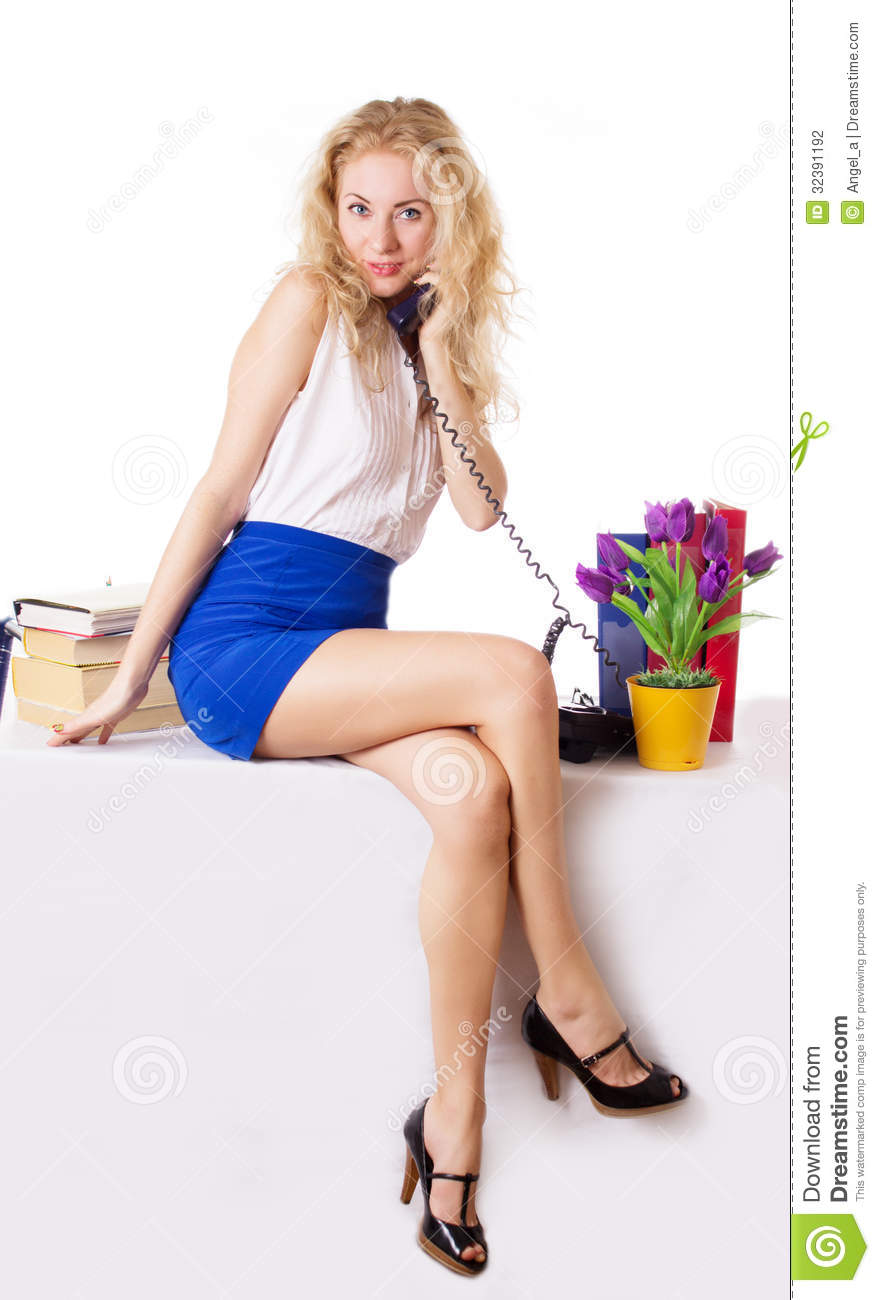 Attractive Businesswoman Sitting On Table With Phone Stock ...