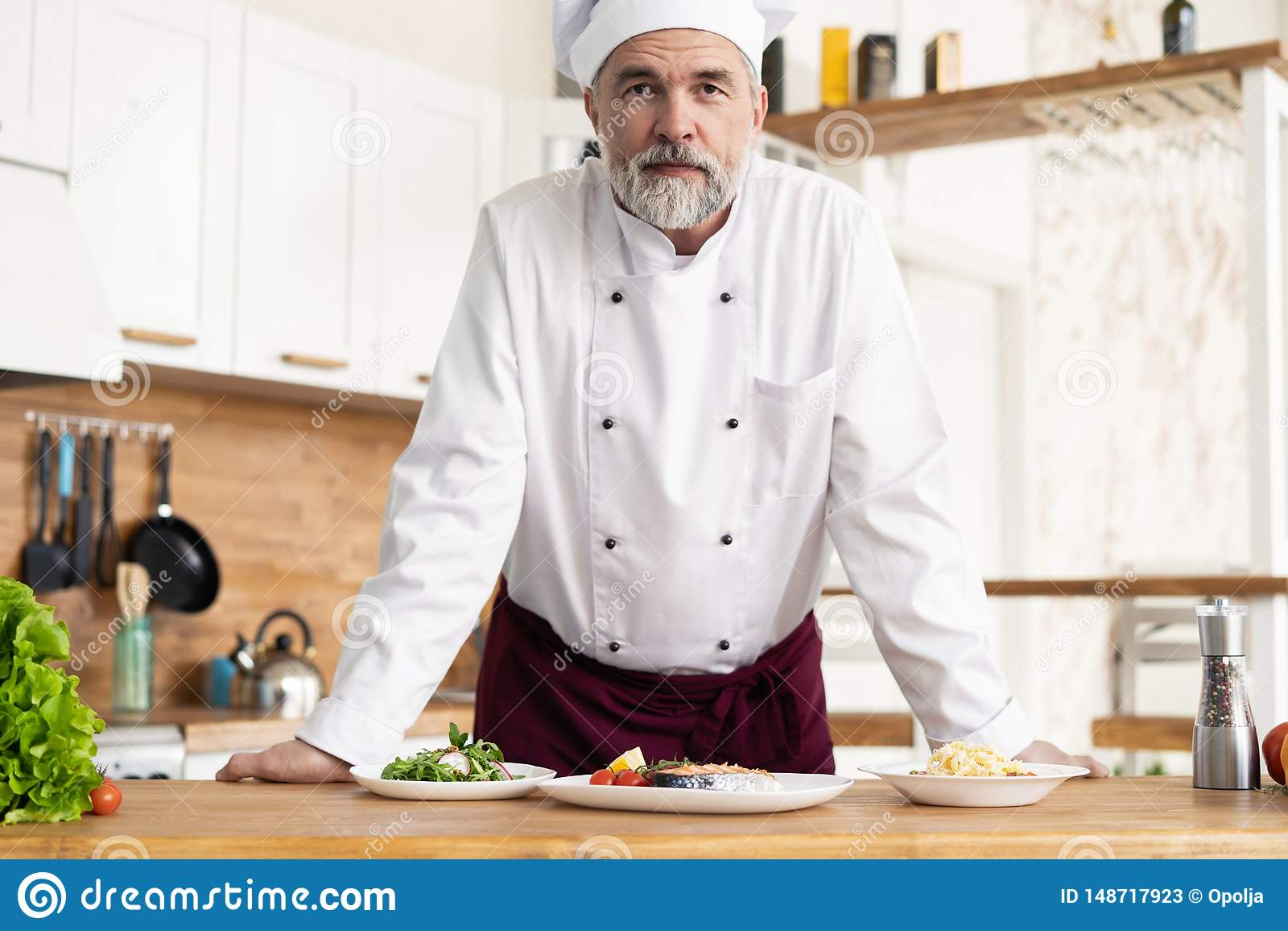 Attractive Caucasian chef standing in a restaurant kitchen