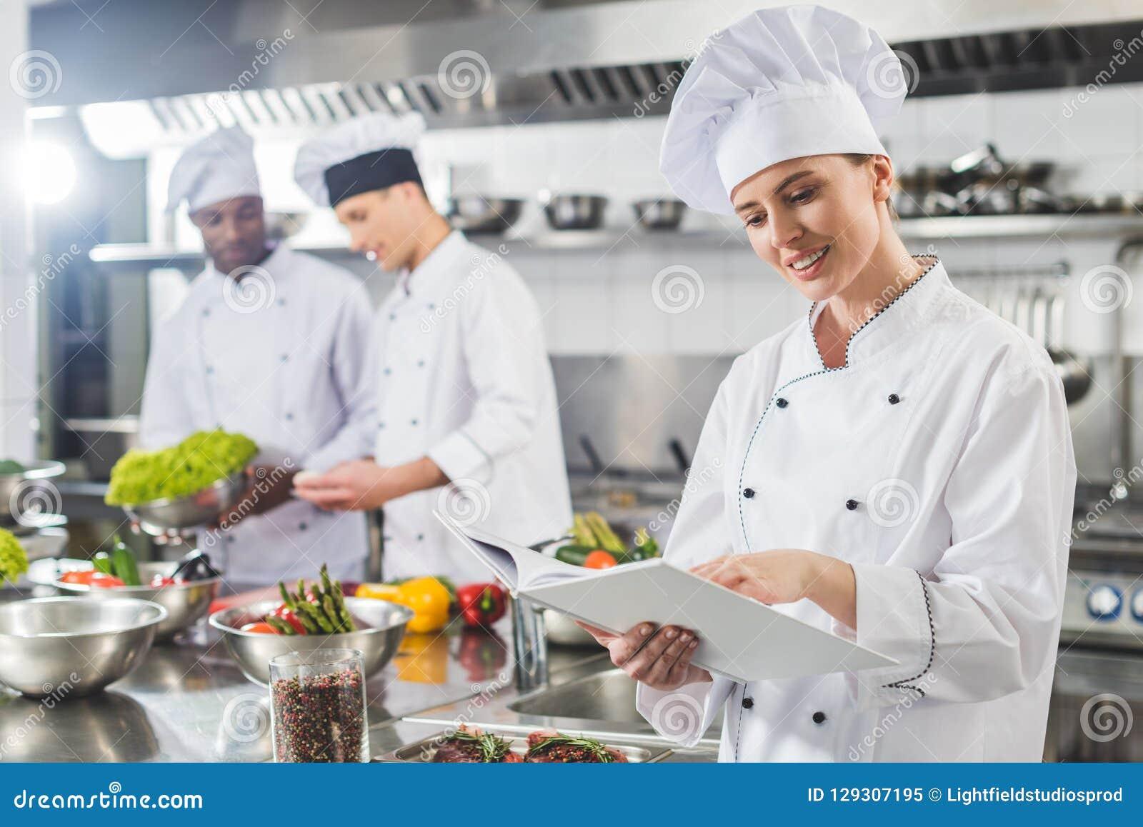 Attractive Chef Reading Recipe In Recipe Book Stock Image