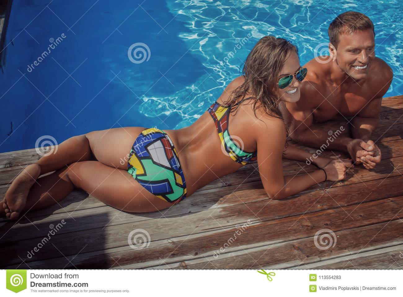 attractive-couple-handsome-muscular-male-sexy-woman-relaxing-near-pool-swimming-enjoying-vacation-women-113554283.jpg