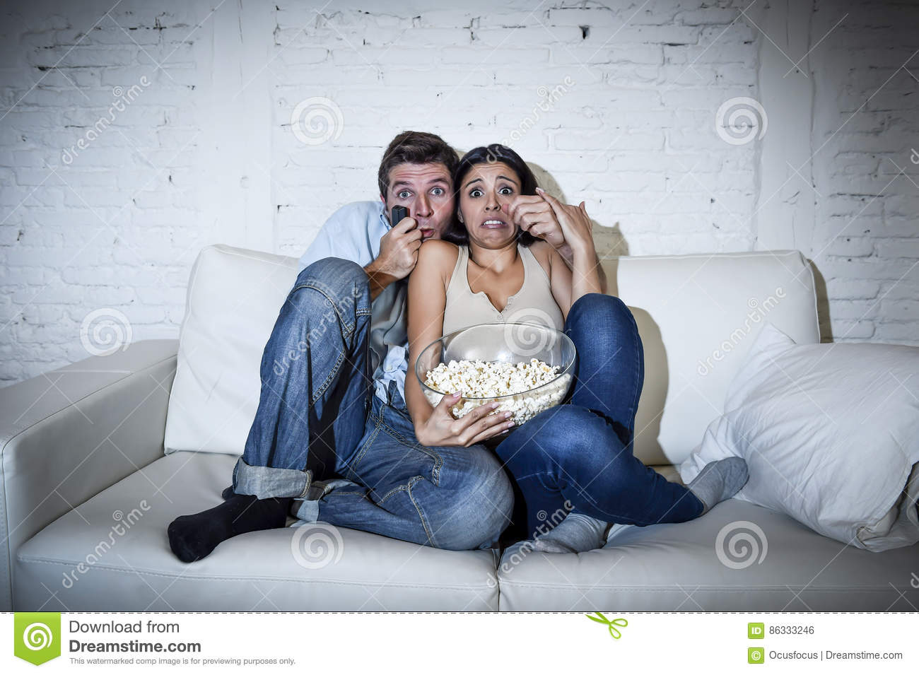 Attractive Couple Having Fun At Home Enjoying Watching