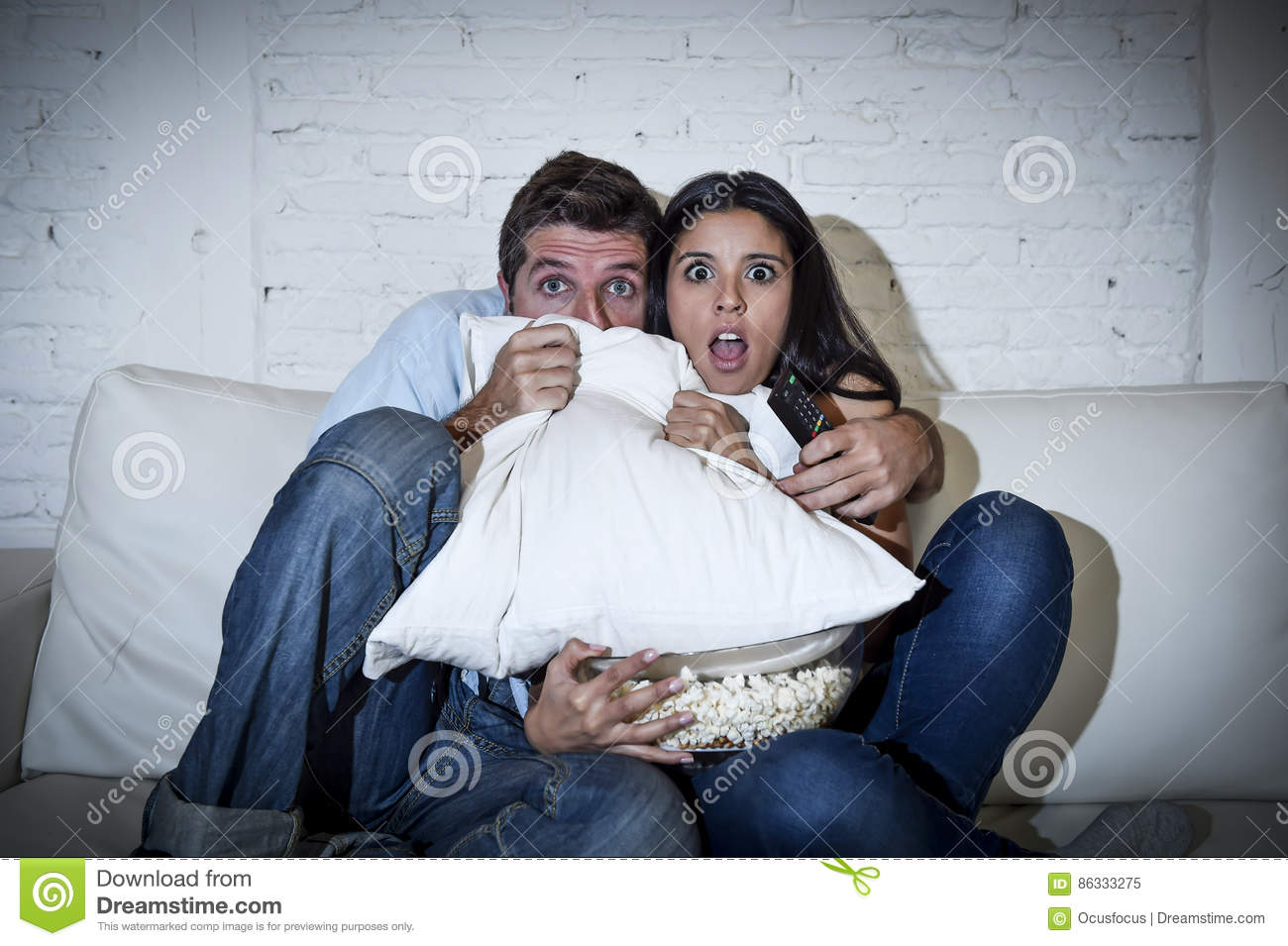 Attractive Couple Having Fun At Home Enjoying Watching Television