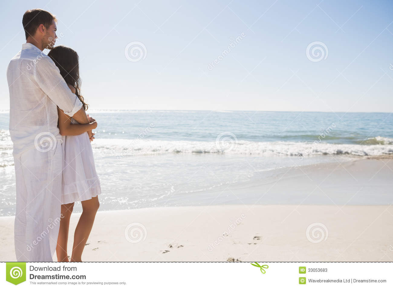 Attractive Couple Looking Out At Sea Stock Image