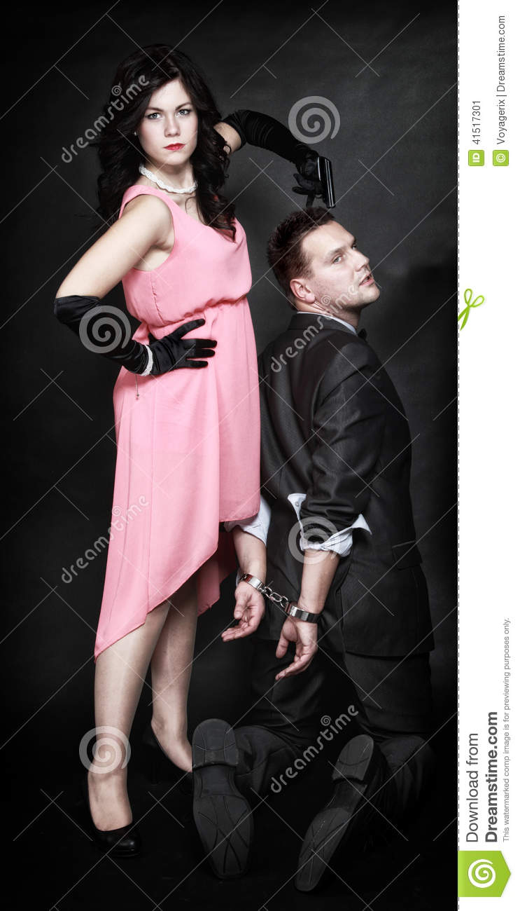 Attractive Couple Woman With Gun Gangster In Handcuffs Stock Image ...