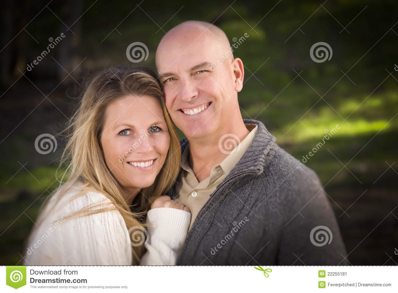 Attractive Couple Wearing Sweaters in Park