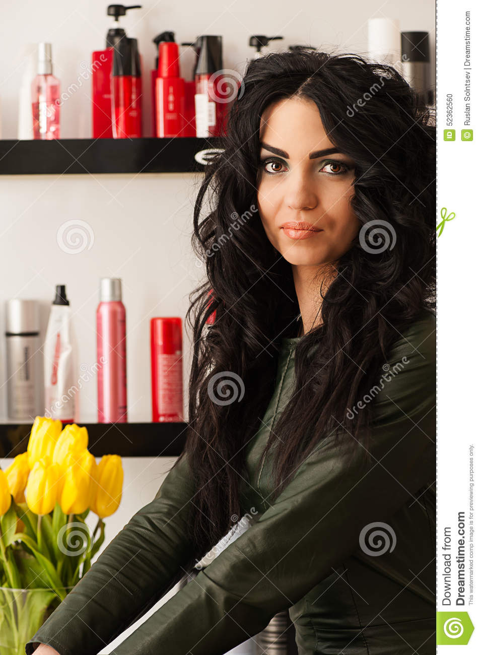 Attractive Curly Haired Woman With Yellow Tulips Stock
