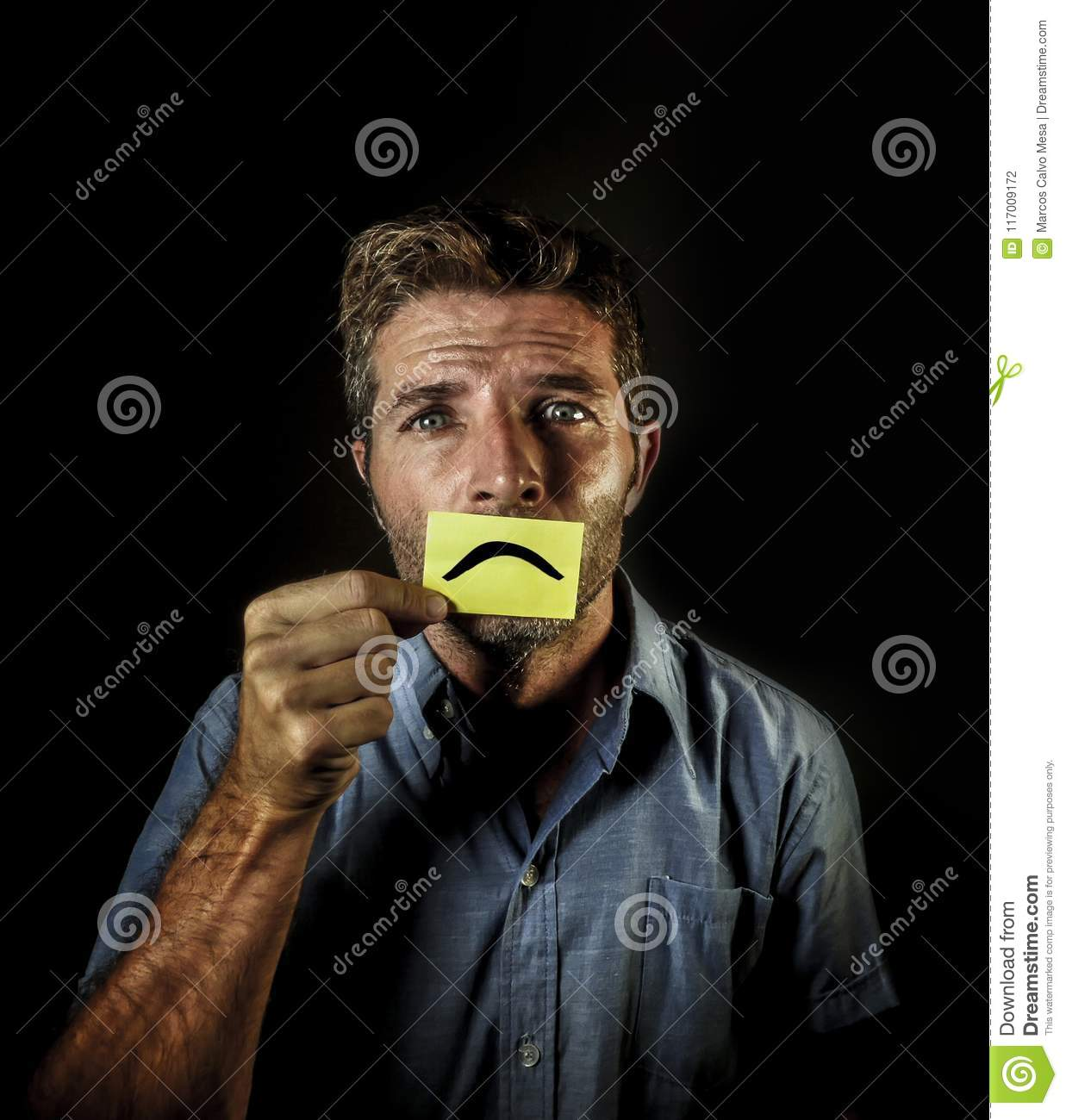 Attractive And Depressed Man Holding Paper With Smiley Sad Mouth