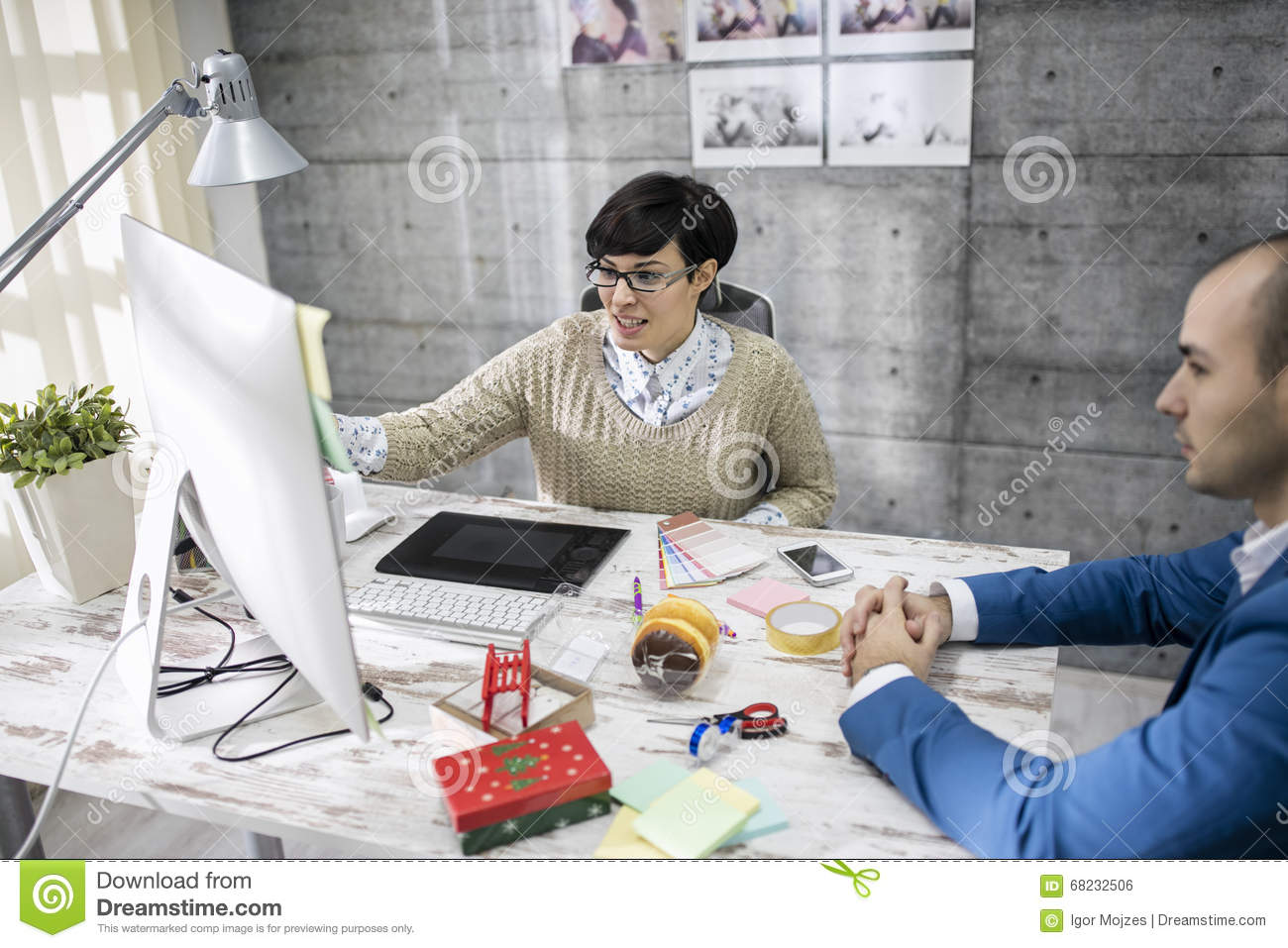 Attractive designer is discussing