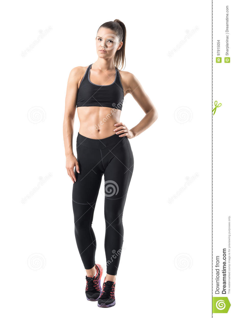 51dfbd9599f72 Attractive determined fit young woman in sports clothing posing with hand  on hip. Full body length portrait isolated on white studio background