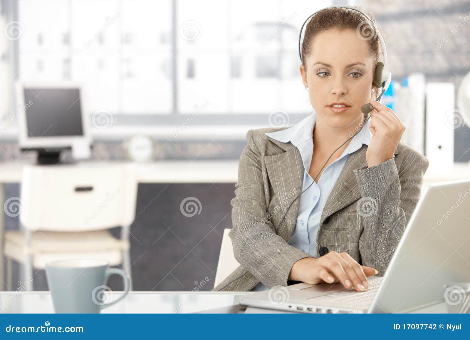 Attractive dispatcher working in bright office