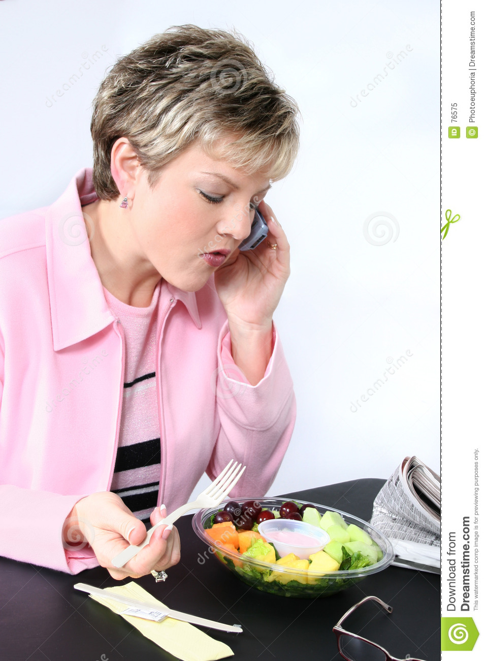 Attractive eating fresh fruit woman