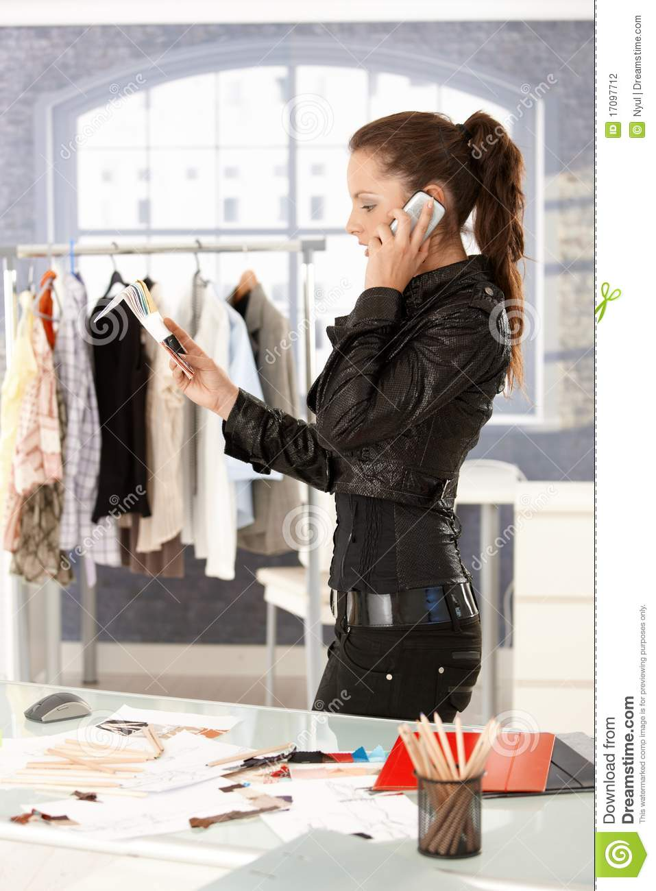 Attractive Fashion Designer Talking On Phone Stock Photo